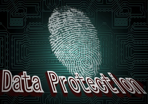 A large fingerprint against computer chipboard, with words Data Protection