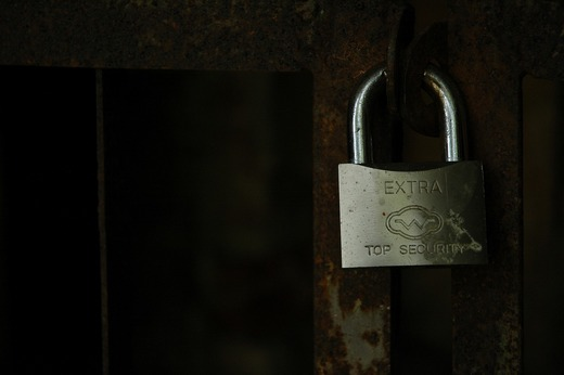 Padlock with words 'Extra top security' on it